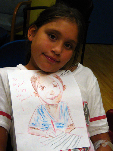 Alyssa with a portrait, drawn by Rami Efal